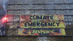 Police arrest Greenpeace activists for mounting climate banner on EU building