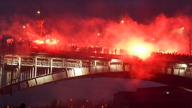 Participants of the nationalist march set off flares on the Poniatowski Bridge in Warsaw